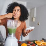 Woman Enjoys Healthy Snacks and Smoothie Between Meals